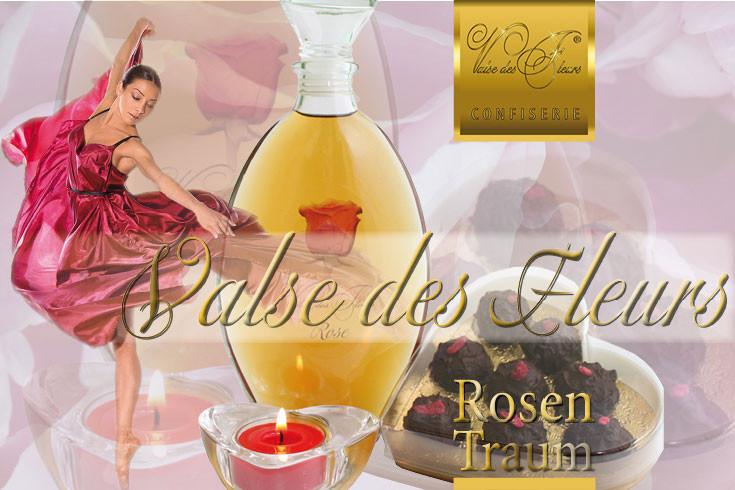 """Geschenk Arrangement mit der """"Königin der Blumen"""". Rosen Weinbrand und Rosen Pralinen arrangiert mit Herzkerzenhalter und Kerze."""